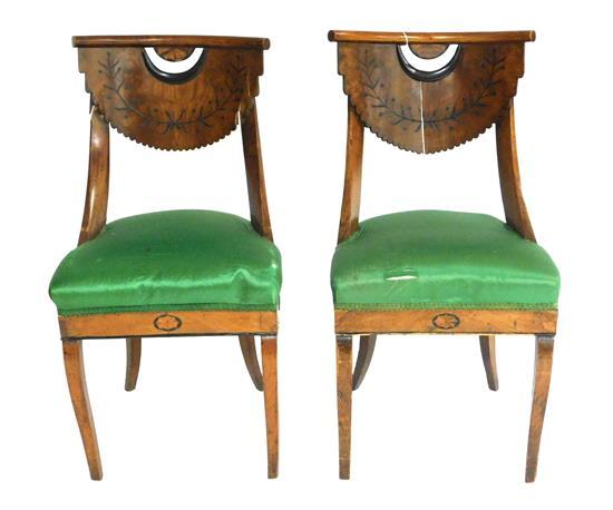 Continental pair of armchairs, c. 1820, with restorations, bentwood crest rail with inlaid fan medallion over scalloped splat, green...