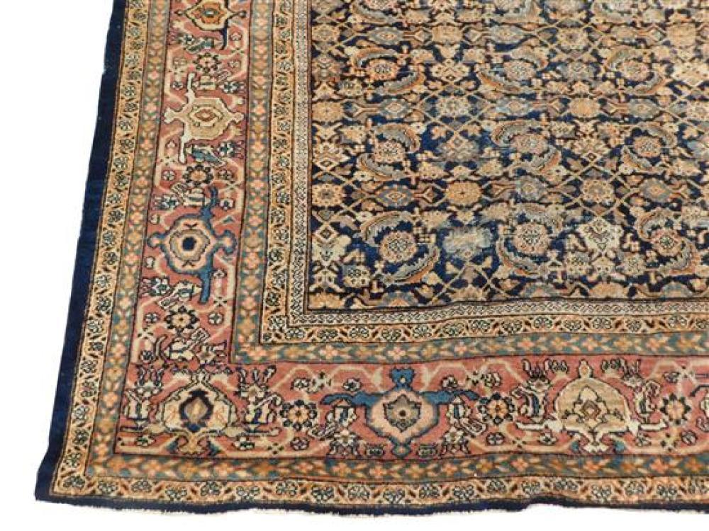 RUG: Antique Persian Mahal, dark navy blue center, allover ferreghan/herati design, classic turtle border, numerous worn areas, and...