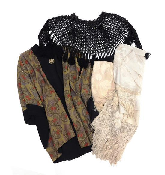 Women's clothing and accessories, five pieces, 19th/20th C., including: black openwork capelet; three white/ecru silk shawls, two wi..