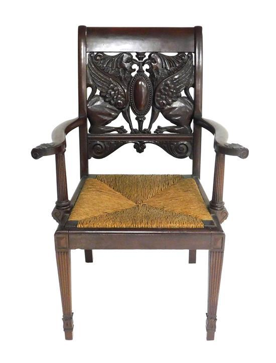 Victorian armchair with ornate carved griffin splat, c. 1900, mahogany, straight crest over intricately carved pair of seated griffi...