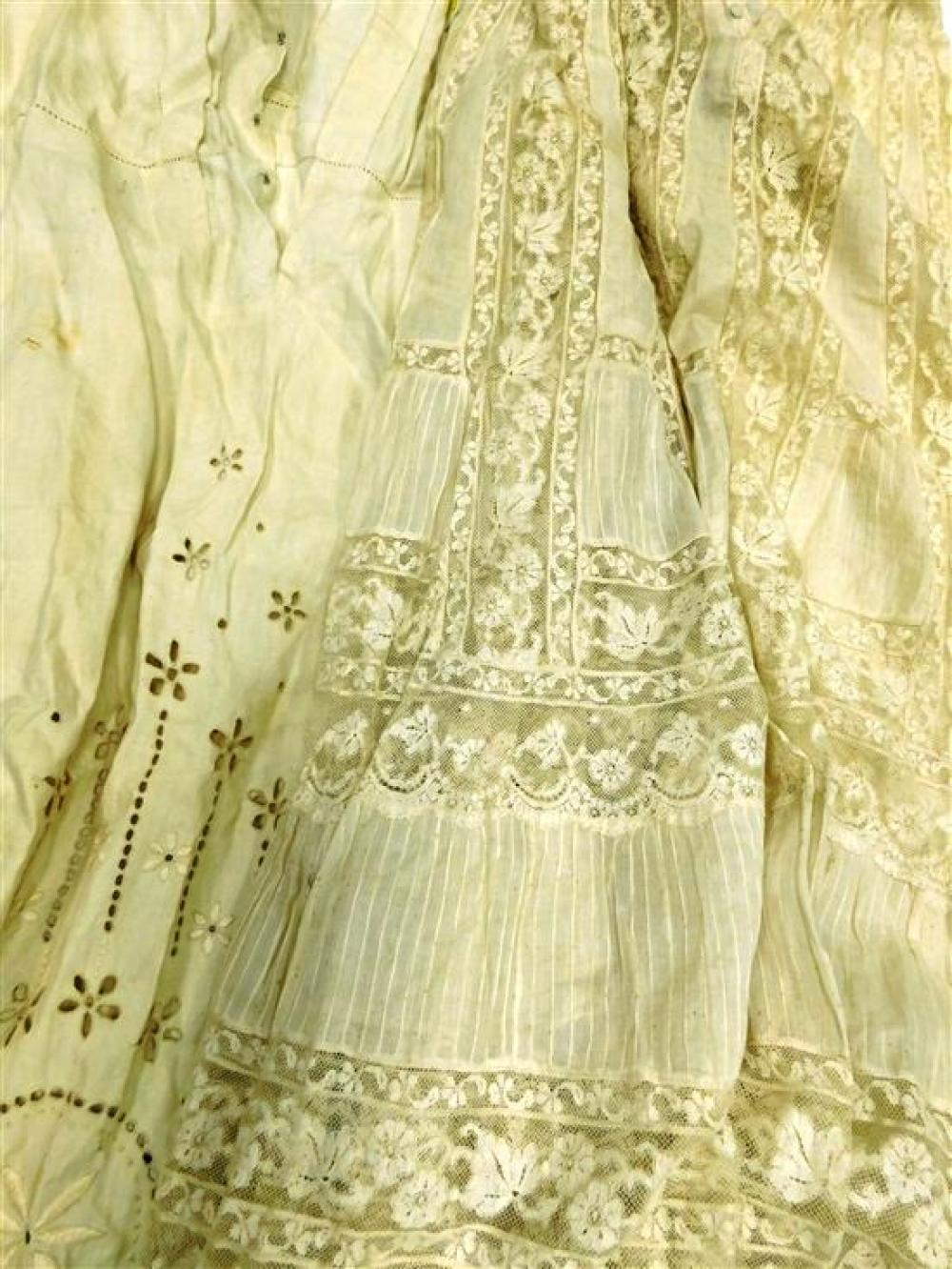 Four Edwardian cotton and lace dresses, wear consistent with age and use including toning, damages, loss, and staining, sold as-is.