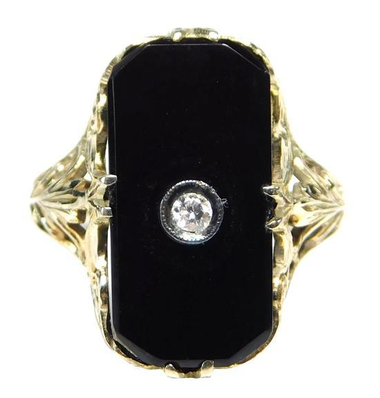 JEWELRY: Vintage 14K Onyx and Diamond Ring: 14K white gold ring with pierced leaf design on shoulders, set with one rectangular tabl...