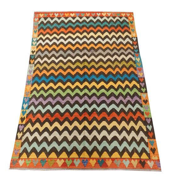 "RUG: Modern Turkish Flatweave, 6' 4"" x 9' 9"", zig-zag pattern of alternating colors of celadon, teal, rust, maize, apricot, gold on.."