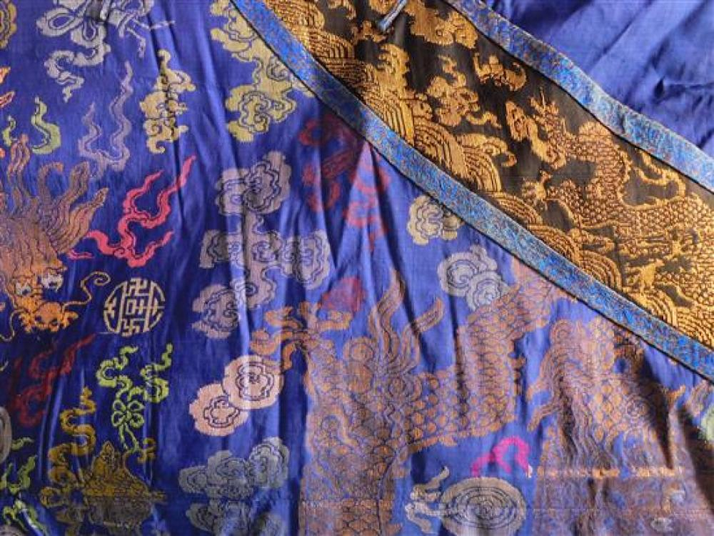 ASIAN: Chinese brocade dragon robe, probably Quin Dynasty, blue with polychrome and gold embroidery, horseshoe sleeves, wear consist...