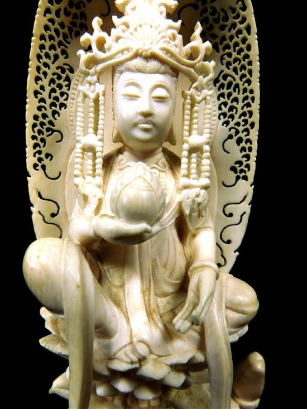 ASIAN: Chinese carved ivory Buddhist figure seated on lotus petal throne and perched on back of bushy-tailed tortoise, figure has po...