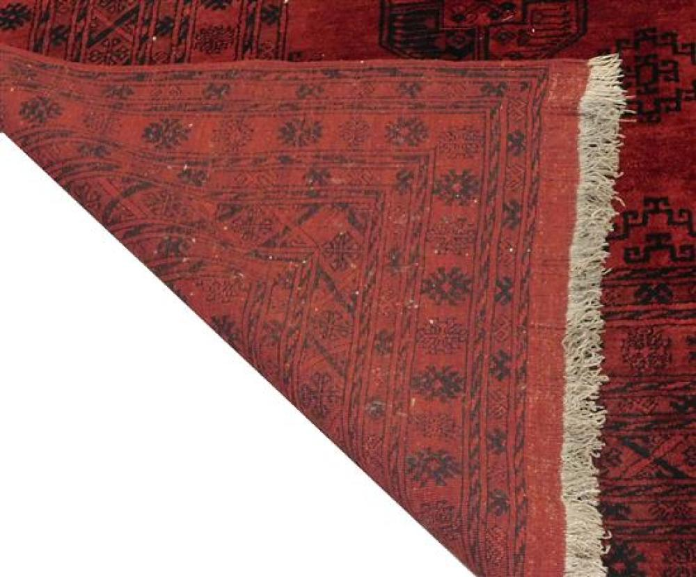 RUG: Modern Afghan design Bokhara carpet, ten medallions on dark red field with black border, 9'8