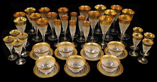 GLASS: Moser 'Splendid' pattern cut stemware, finger bowls and underplates, forty-four pieces with gilt decorated rims: eight wines .
