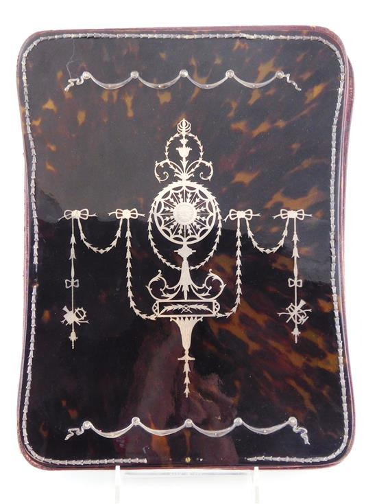 Portfolio, 19th/20th C., tortoise shell cover with silver overlay and bellflower design, wear consistent with age and use including...