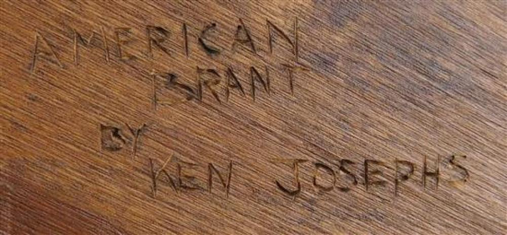 """Ken Josephs (American, 20th C.), two bird carvings: """"Golden Eagle"""", American eagle wood carving on branch and pedestal base, signed..."""