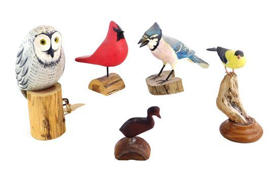 "Five bird carvings, 20th/ 21st C., all signed, pieces include: small yellow bird on branch base, signed ""Ken Josephs""; cardinal sign..."