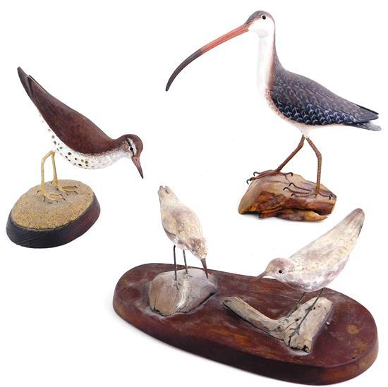 "Three carved shorebirds, 20th C., two signed, including: single bird on oval base signed ""C. A. Bowman"" along with etched monogram o..."