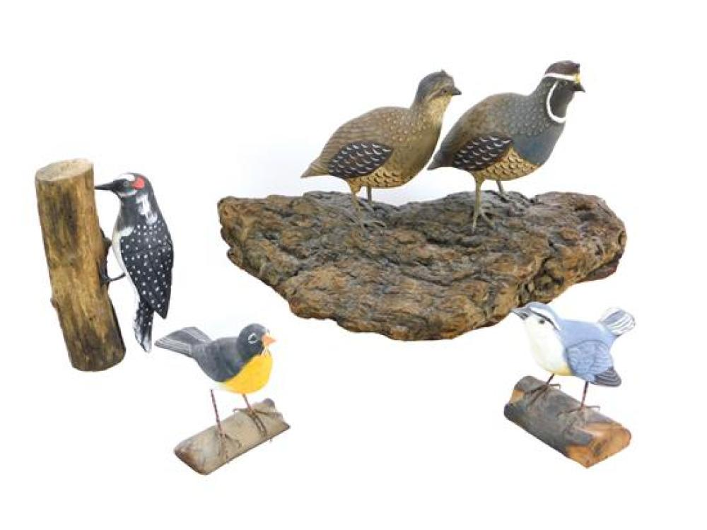 """Four bird carvings, late 20th/ early 21st C., including: largest a pair of quails mounted on bark, 15"""" l.; wood pecker on trunk, 7 1..."""