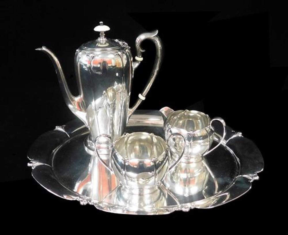 "STERLING: Watson Co. (Attleboro, Mass, 1880-1955) four piece ""Lotus"" pattern tea service, 19th/20th C., includes: teapot, lobed tape..."