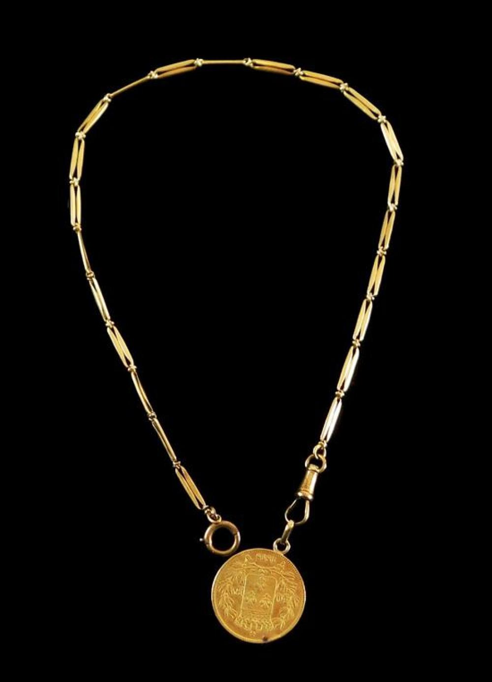 JEWELRY: 14K watch chain with gold 40 Francs French coin, chain: long bar link with spring ring and swivel clasps, tested 14K yellow...