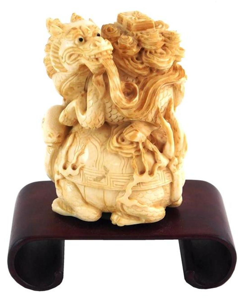 ASIAN: Ivory sculpture of dragon on riding on a tortoise, Chinese, 19th/ mid-20th C., intricately carved and pierced, no visible sig...