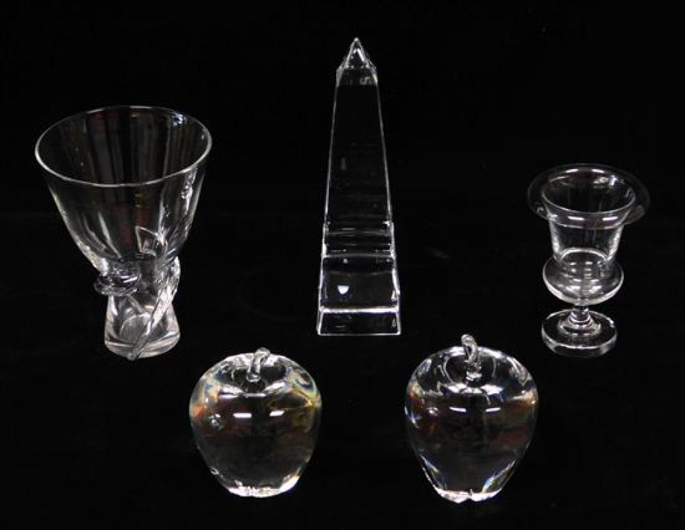 "GLASS: Steuben crystal, 20th C., five pieces, including: two apples, 4 ¼""h. and 4 ¾"" h.; an urn, 5"" h.; vase, 6 1/8"" h.; and an obel..."