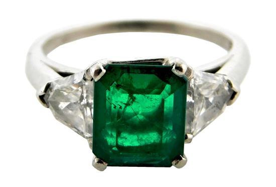 "JEWELRY: Platinum emerald and diamond ring, mounting: stamped and tested ""IRID PLAT"", platinum, half round shank with four prong cen..."