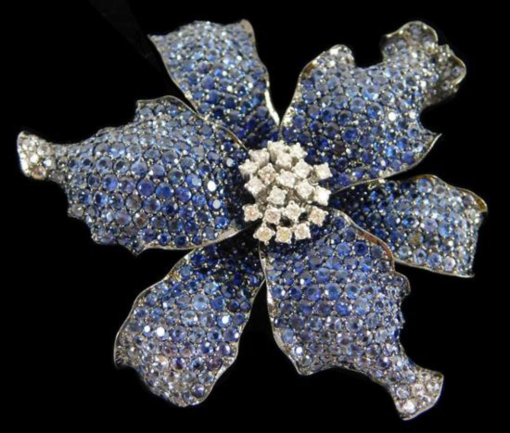 "JEWELRY: 18K Sapphire and Diamond Brooch: stamped and tested ""750"", 18K black gold, floral design with double pin stem on back, diam..."