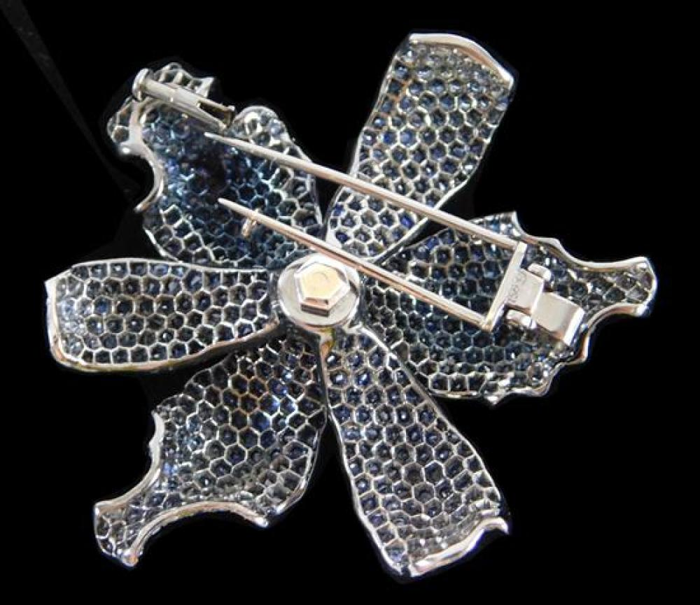"""JEWELRY: 18K Sapphire and Diamond Brooch: stamped and tested """"750"""", 18K black gold, floral design with double pin stem on back, diam..."""