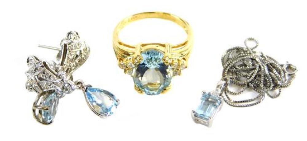 JEWELRY: Three Pieces of Aquamarine jewelry set in 14K gold, including: one 14K yellow gold Aquamarine and diamond ring, aquamarine-...