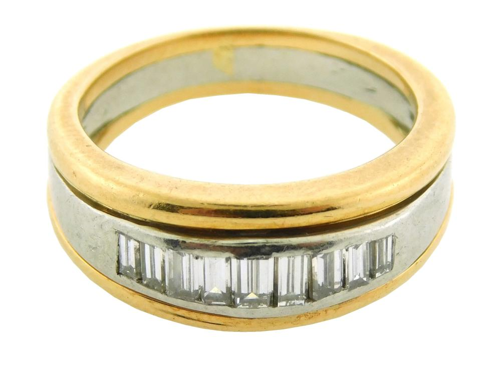 JEWELRY: 18K yellow gold and platinum band inset with diamond baguettes at center, platinum edged in 18K yellow gold, finger size: 5...
