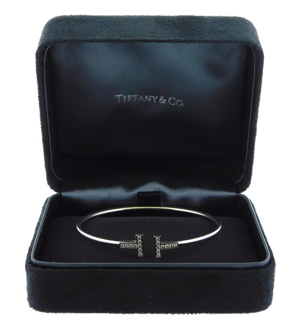 "JEWELRY: 18K Tiffany & Co. Diamond ""T"" bracelet, wire ""T"" bracelet is stamped ""T & Co. 750 Italy"" 18K white gold, medium size fits w..."