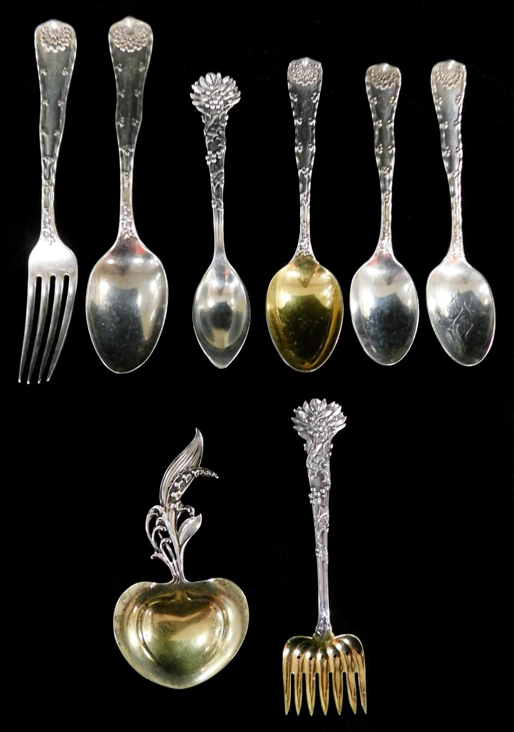 STERLING: Tiffany & Co., eight pieces of flatware and servingware, patterns include Holly, Wave Edge, etc., all pieces marked sterli...
