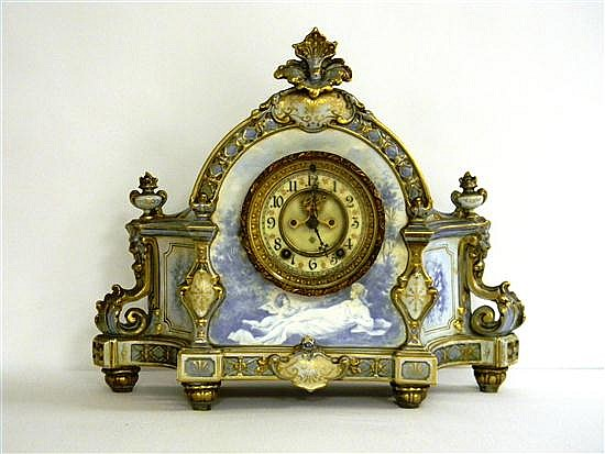 Ansonia Royal Bonn China mantleclock, white porcelain case with blue and gilt leaf accents, decorated around bezel with classical mo...