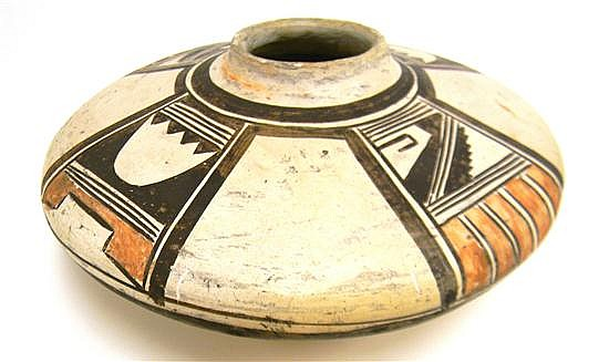 TRIBAL: Hopi Pueblo, Arizona pottery bowl, possibly by Nampeyo, early 20th C., flattened disc shape with convex base, brown and blac...