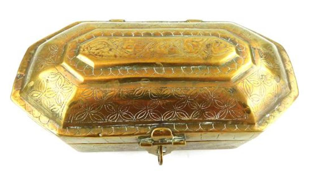 Three early engraved brass tobacco boxes, details include: one oval with couple at table; one cut corner oblong with cupids; and the...