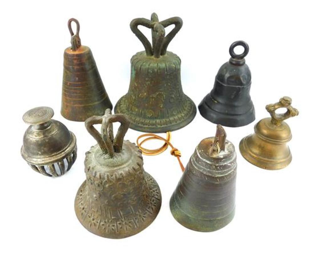 """Seven bells, most bronze, probably 18th-20th C., including Continental, two Mexican mission bells, one inscribed """"Mejico"""", and an ea..."""