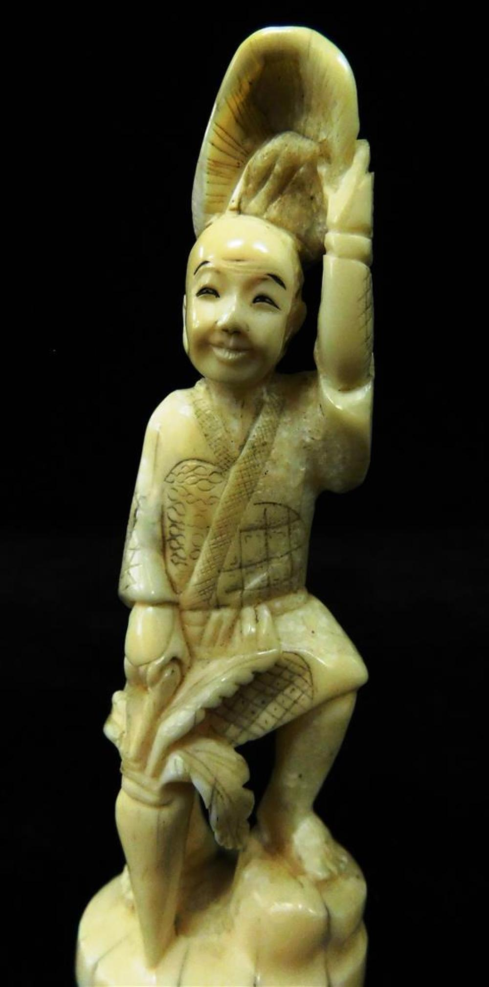 ASIAN: Two carved ivory figures, 19th/20th C., one Japanese and modeled as a man holding a hat; the other Chinese, modeled as a woma...