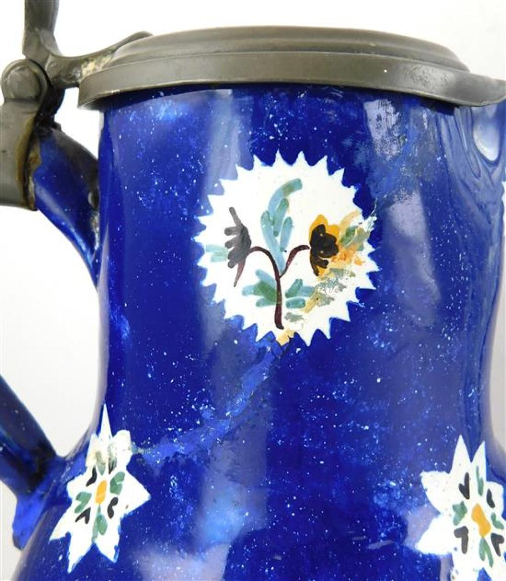 Faience porcelain, two pieces, including: pitcher with pewter lid, probably Brussels, 18th/19th C., floral decoration on blue ground...