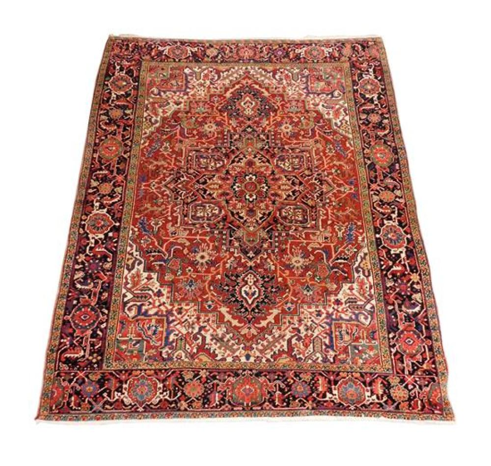 """RUG: Persian Heriz, 10' 4"""" x 8' 2"""", 100% wool on cotton, classic turtle navy main border, central black medallion on brick red field."""
