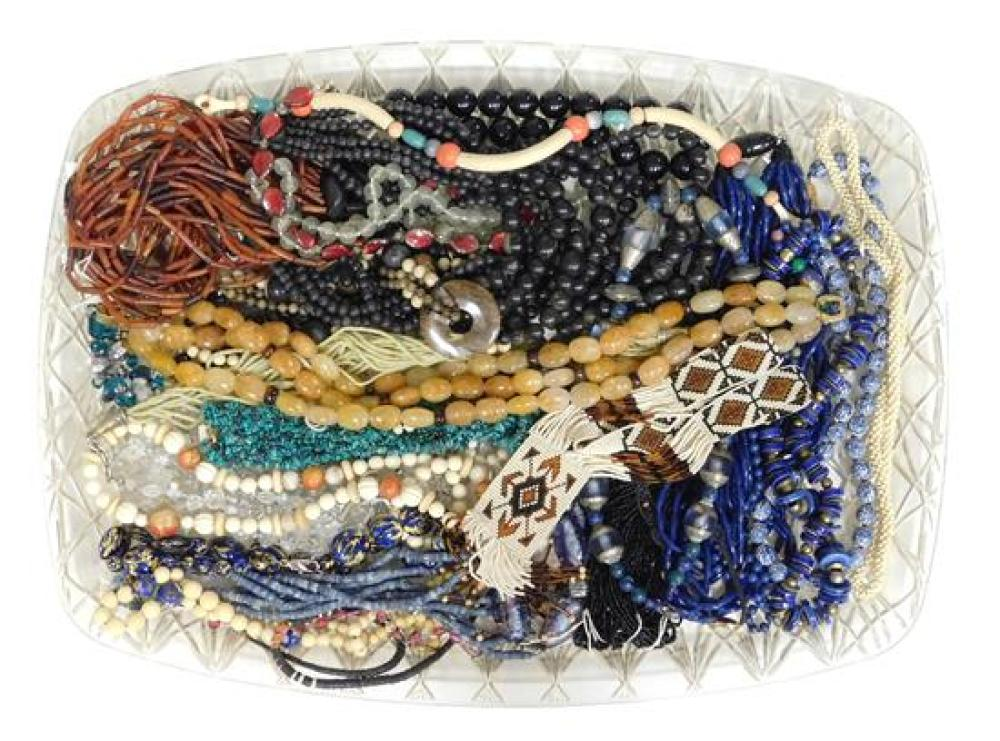 COSTUME JEWELRY: 30+ Necklaces, materials include a variety of hard-stone, art glass, ceramic/ porcelain beads, etc., wear consisten...
