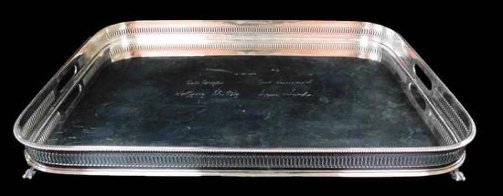 SILVER: Continental '800' silver waiter/tray, oblong with reticulated gallery, raised on four feet, presentation inscription with na.