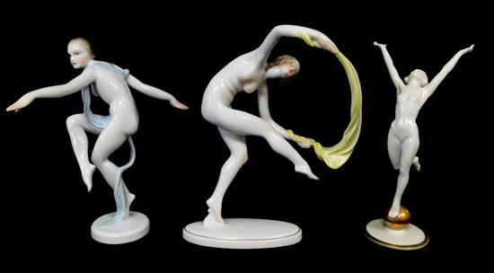 "Herend, etc., three porcelain figurines, 20th C., including: two Herend dancing nudes, both signed, 9 ¼"" and 8 ¾"" h.; and a dancer a..."