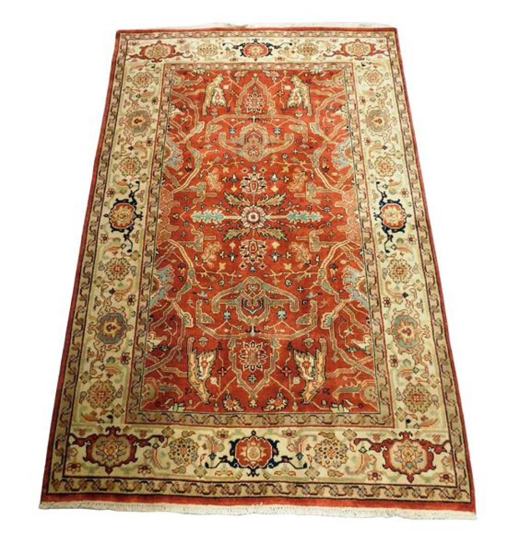 """RUG: Serapi, 5'10"""" x 9', hand-knotted, 100% wool on cotton, foliate vine design on cranberry ground, wide cream border with alternat."""