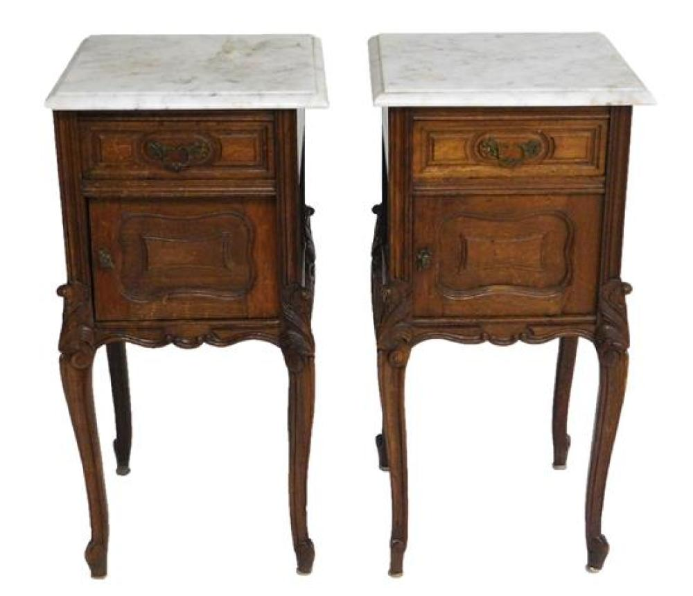 Two Louis XV style stands and a bedstead, oak, details include: stands with white marble tops over single drawer and cabinet, one do...