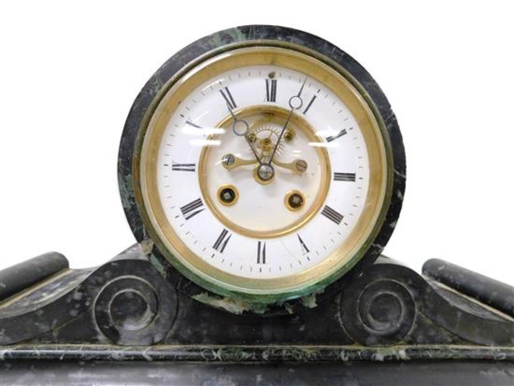 Marble mantel clock, late 19th / early 20th C., unknown maker, green, black and white variegated marble, round case, flanked by scro...