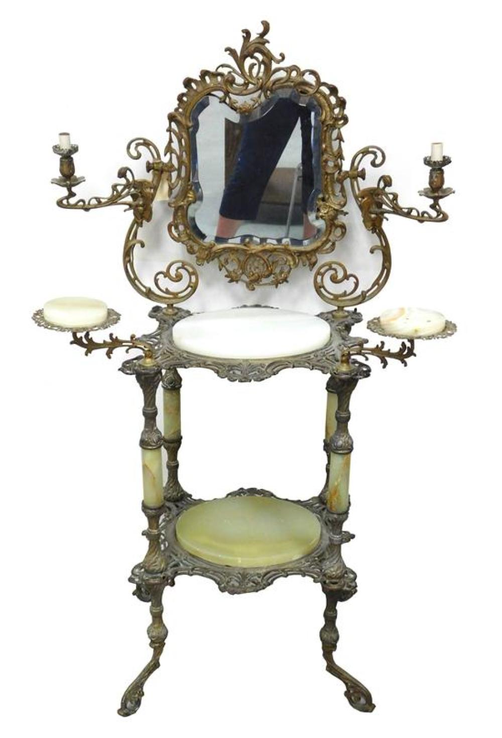 Brass and onyx vanity/ shaving stand with beveled mirror, two candle arms, green oval inset stone with veining, wear consistent with...