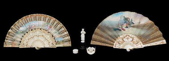 """Continental carved ivory or ivory type, five pieces: two painted and signed fans, 19th/early 20th C., larger fan: 9"""" l.; ram's head..."""