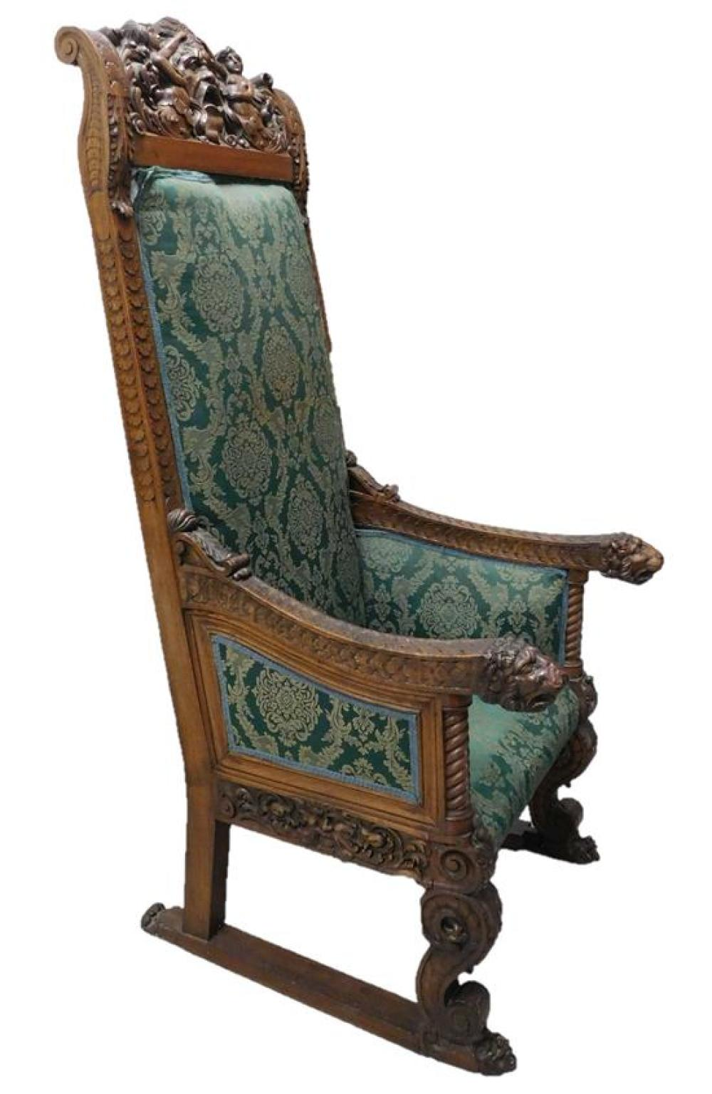Monumental Baroque Revival throne chair, late 19th C., masque and mermaid carved crest, elaborate carvings throughout, green upholst...