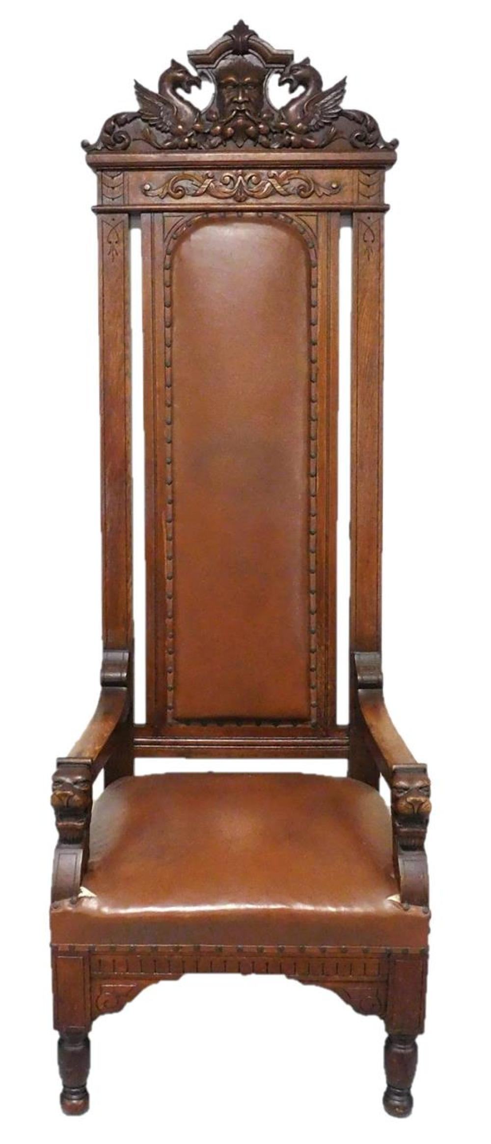 Monumental Renaissance Revival throne chair with masque and griffin carved crest, late 19th C., dark mahogany stain, elaborate carvi...