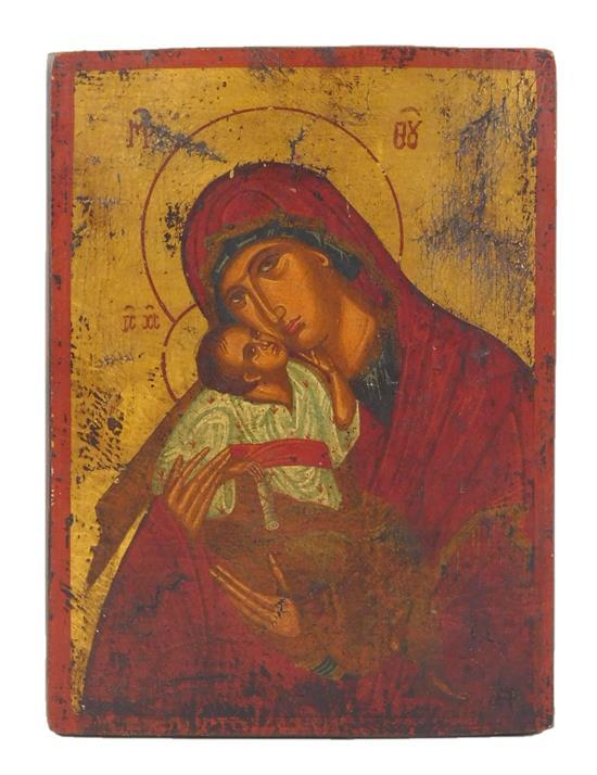 """Russian icon on panel, Madonna and Child type figures, paper label verso, wear consistent with age and use, 10 1/4""""h. x 7 1/2""""w."""