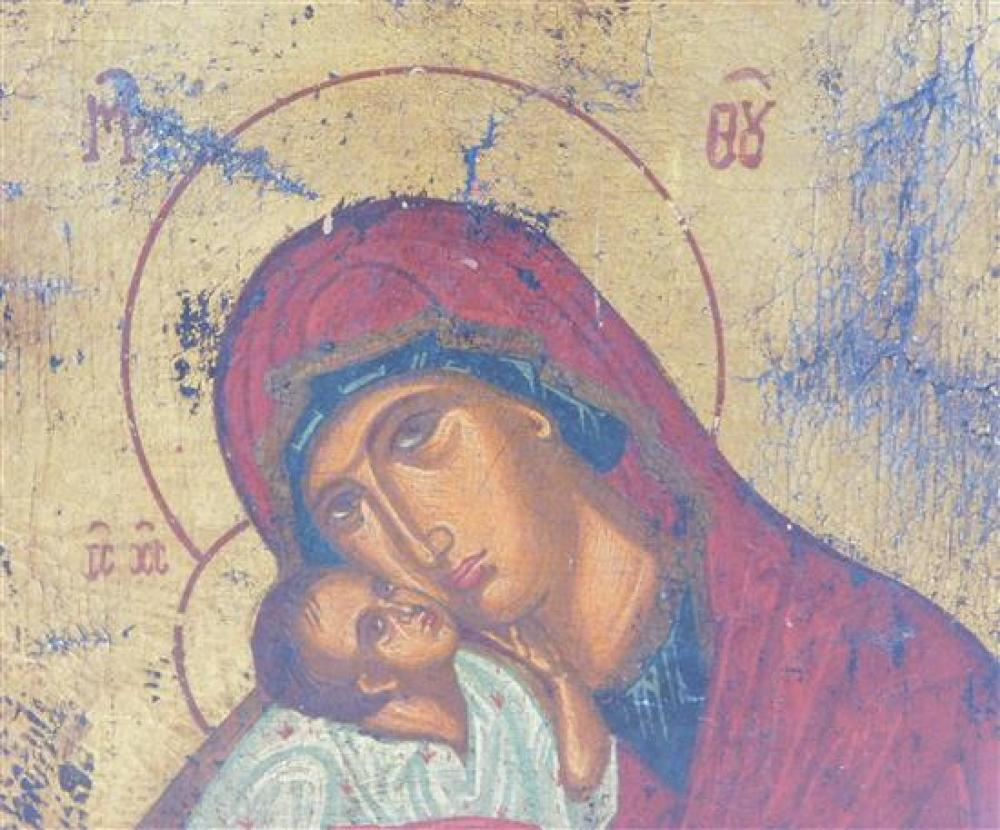 Russian icon on panel, Madonna and Child type figures, paper label verso, wear consistent with age and use, 10 1/4
