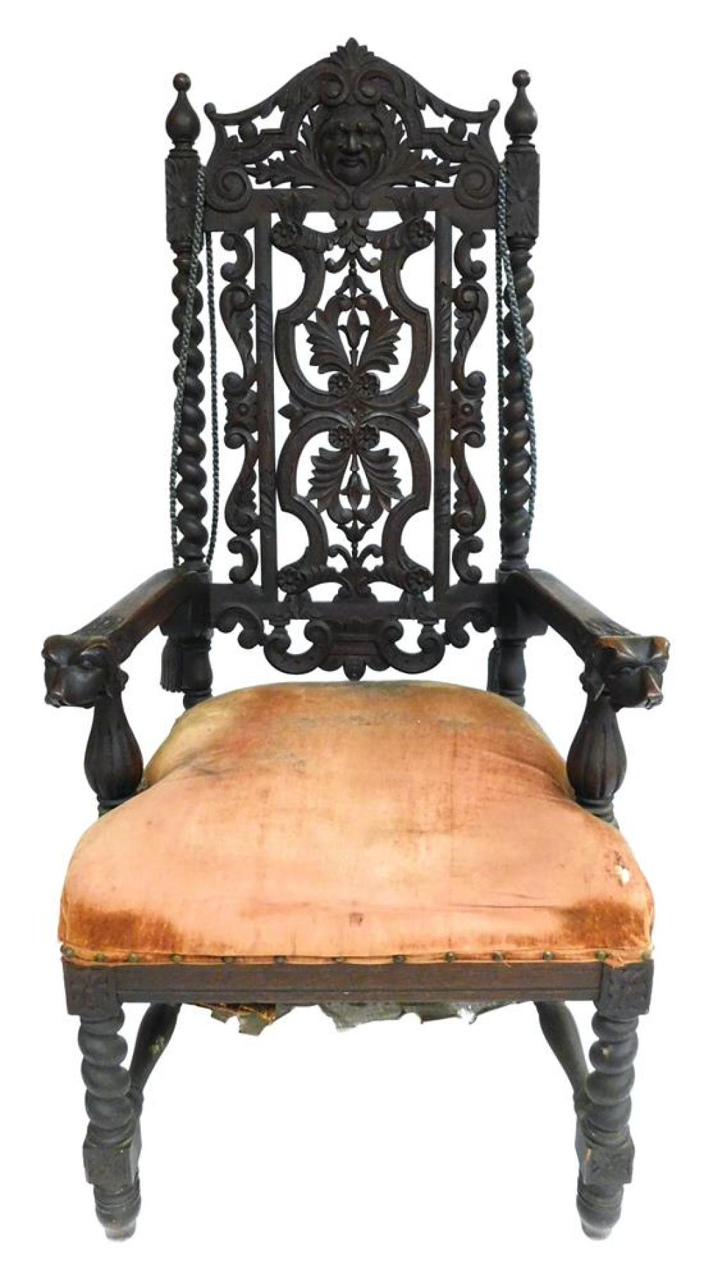 Victorian carved armchair with dog-head hand rests, ornately pierced backrest, upholstered seat, sold as found with seat in poor con...
