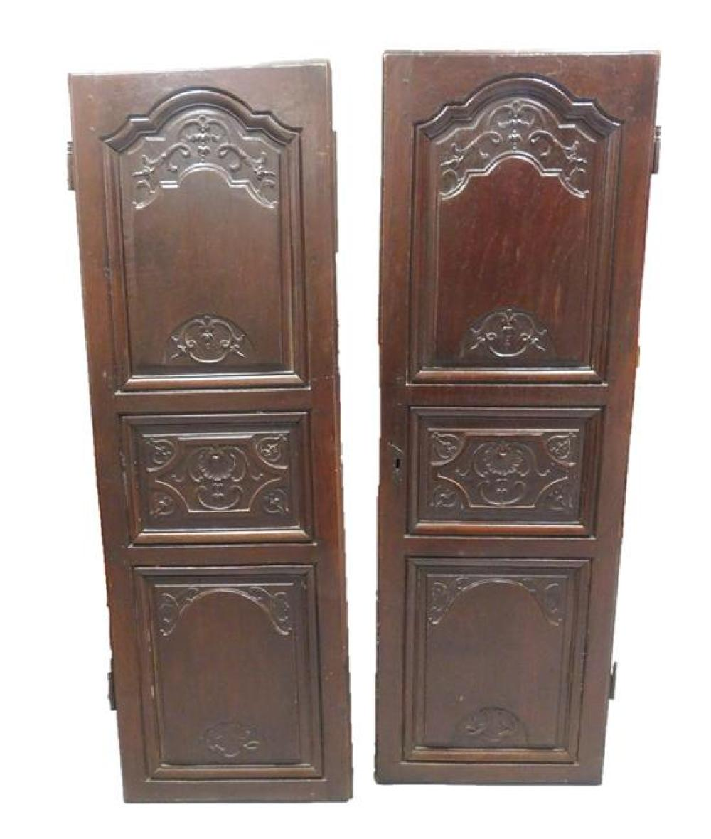 Architectural carved doors, pair, 19th C. oak with dark stain, each with three panels featuring shell, scroll and bellflower decorat...