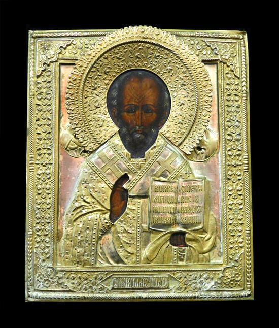 """Russian icon on panel with gilt metal riza, 19th/20th C., depicting St. Nicholas, wear consistent with age and use, 10 1/2"""" h. x 9"""" w."""