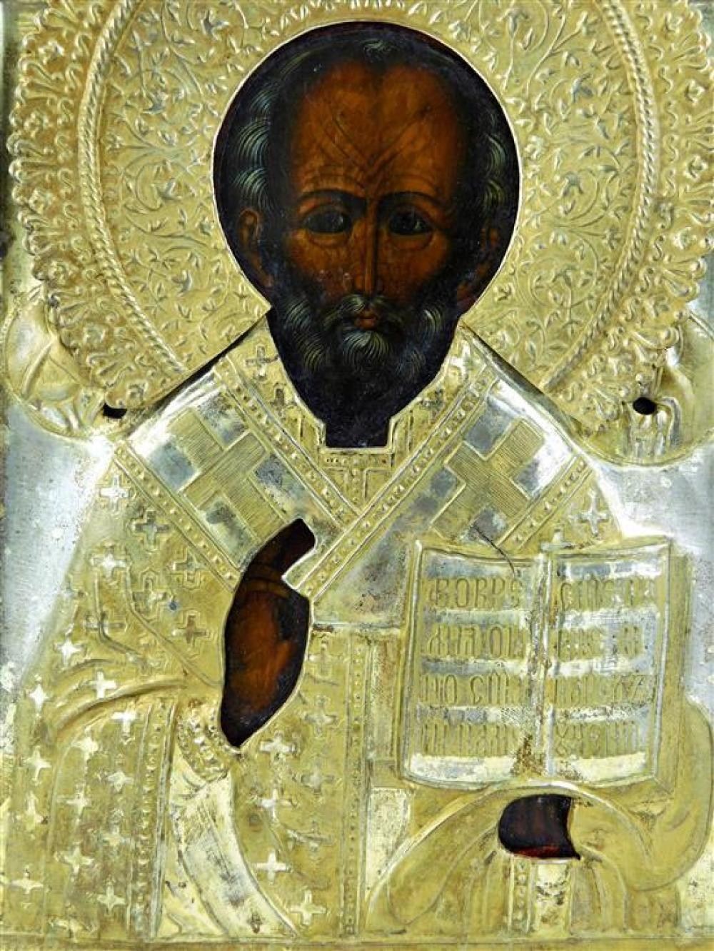 Russian icon on panel with gilt metal riza, 19th/20th C., depicting St. Nicholas, wear consistent with age and use, 10 1/2